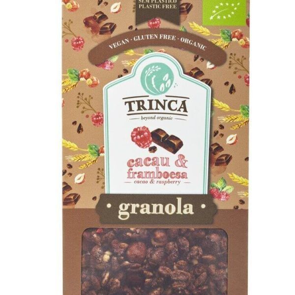 Granola de cacao y frambuesas de la marca Trinca. 400 gramos de auténtica delicia nutricional. Pepitas de cacao con azúcar de coco. Copos de avena, frambuesas y muchas más cosas deliciosas y nutritivas.